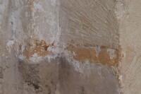Detalle del muro donde se aprecian los restos de pintura